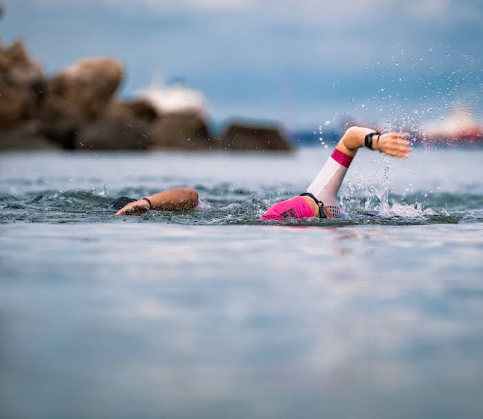 Triathletes swimming in open water